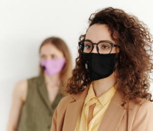 Two women with masks