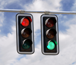 One red stoplight and one green one