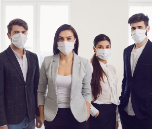 Confident business people with masks on